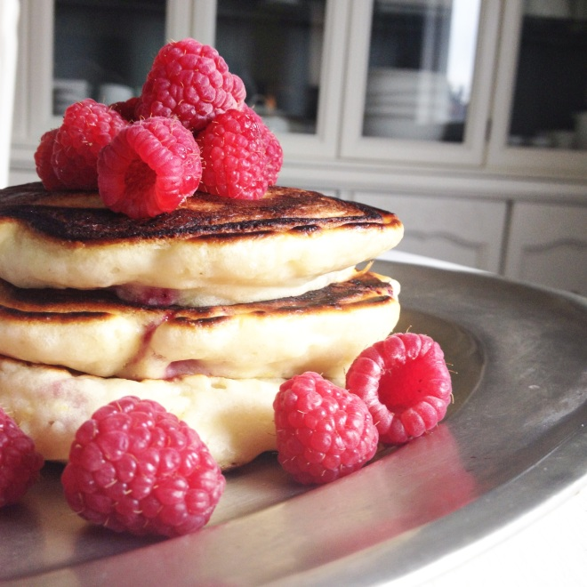 Angel Cake Pancakes with raspberries on silver platter