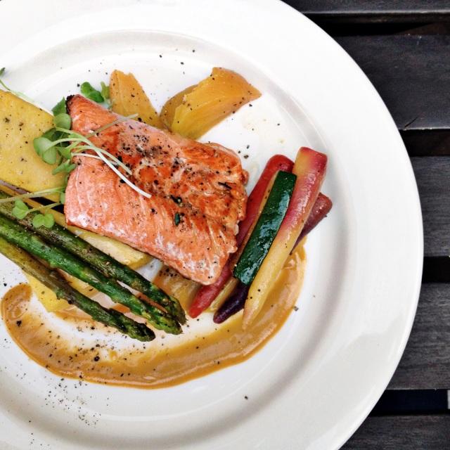 Salmon and roast veggies on white plate