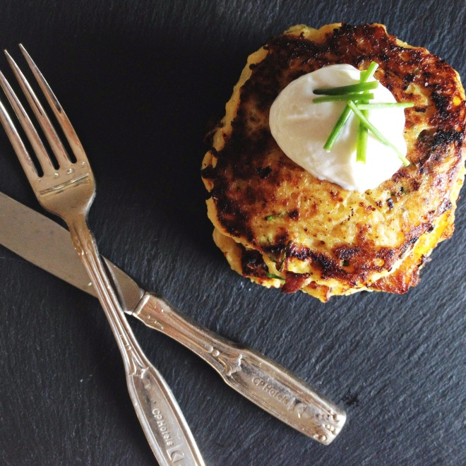 spaghetti squash fritters topped with sour cream