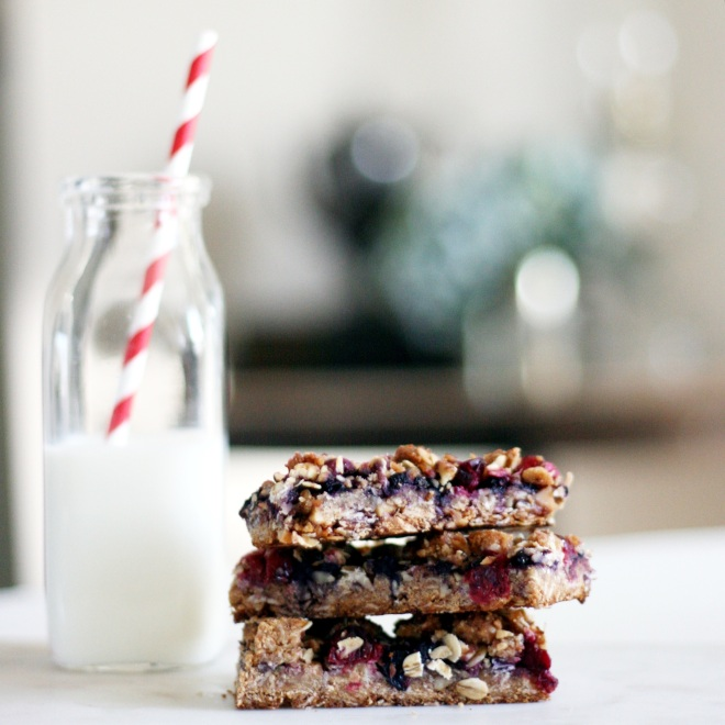 Almond berry breakfast bars with glass jug of milk