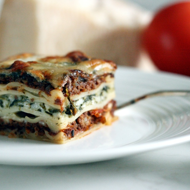 Rustic Italian lasagne on white plate