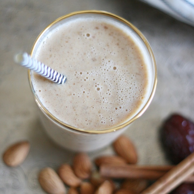Chai tea smoothie in gold rimmed glass