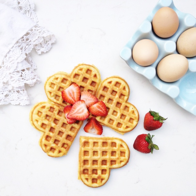 Buttermilk waffles topped with fresh strawberries